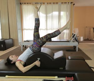 I am my own Spine Corrector: How to Lower your Legs in the Hundred